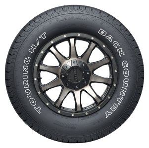 Back Country QS-3 Highway Tire sidewall view, outlined white lettering